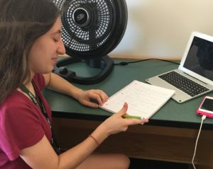 Katherine Colleran works on the assignment given in The Bobby Hawthorne Experience, writing a profile on Chad.